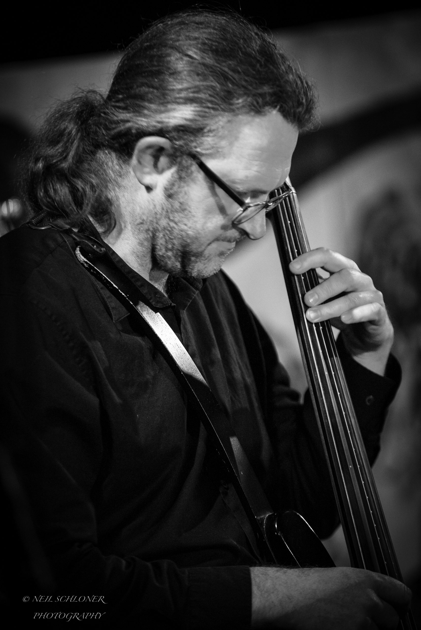 Aaron Kerr playing electric cello