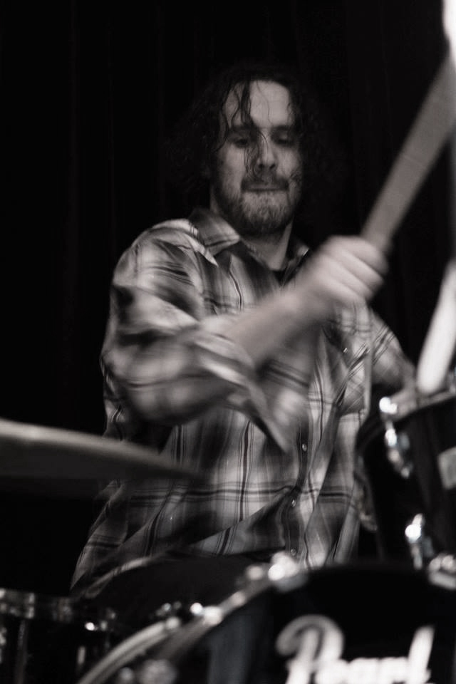 Justin DeLeon playing drums