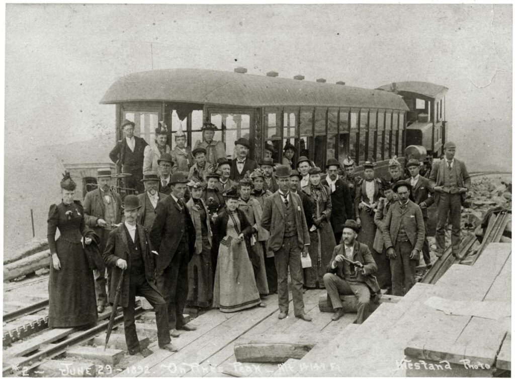 Group of train riders at Pikes Peak summit in 1892